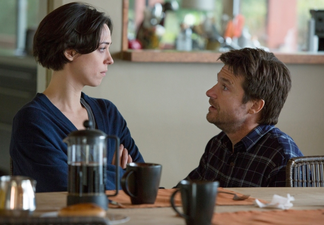 "This photo provided by STX Productions LLC shows, Rebecca Hall, left, and Jason Bateman, in a scene from the film, ""The Gift."" The movie opens in US. theaters on Aug. 7, 2015. (Matt Kennedy/STX Productions, LLC via AP)"