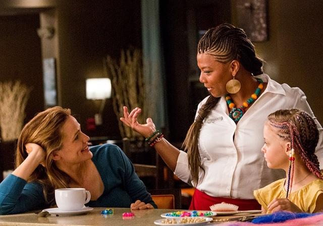 Queen Latifah conversa com a família