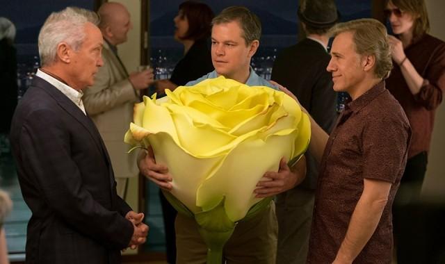 personagens conversam com uma rosa gigante na mão